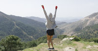 Young successful boxer on top of mountain