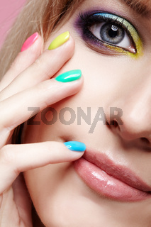 Closeup  image of human female eye with violet shadows, blue and and yellow makeup