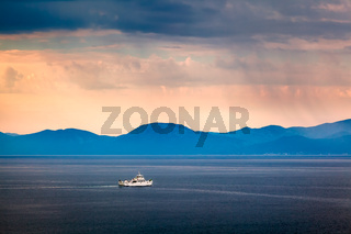 Boat Passing Island of Brac in the Rainy Morning, Croatia