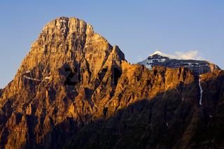 Mountain peak illuminated by early morning light