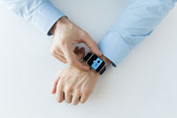 hands with smart watch and social media icons