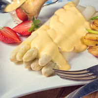 Asparagus , hollandaise sauce and baked potatoes