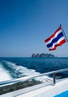 Thai flag on the boat over beautiful sea and summer blue sky background