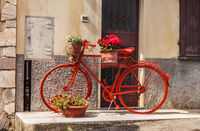 Red bike against a wall