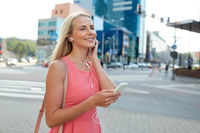 happy young woman with smartphone and earphones