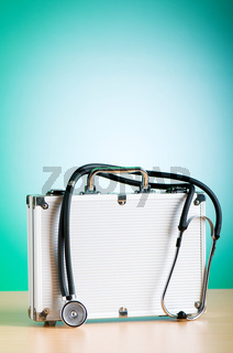 Doctor's case with stethoscope against colorful background