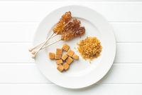 Brown cane sugar, cube sugar and crystalline sugar.
