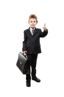 Businessman child boy holding briefcase gesturing thumb up success sign