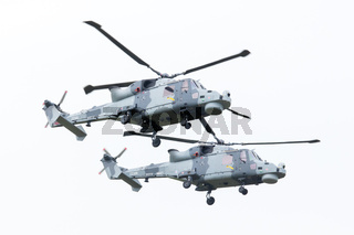 LEEUWARDEN, THE NETHERLANDS - JUNE 11, 2016: Royal Navy (Black Cats Display Team) Agusta Westland AW-159 Wildcat HMA2 performing some flights at the Royal Netherlands Air Force Days
