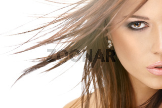 Close up - a half of face of beauty with flying hair