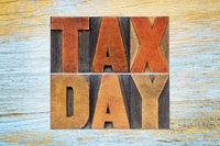 tax day word abstract in vintage wood type