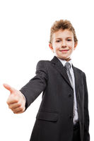 Smiling young businessman child boy gesturing thumb up success sign