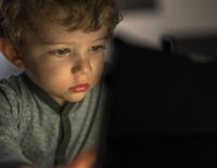 infant boy watching an tablet