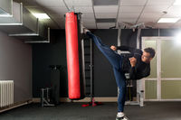 At gym. Photo of boxer training his kick