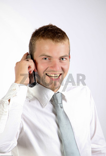Cheerful Man Talking On The Phone In A Corporate Attire