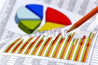 pencil laying on financial business chart