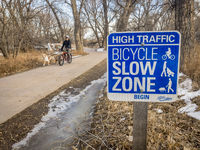 Bicycle slow zone sign on Poudre Trail