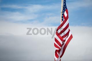 american flag flying on blue sky background