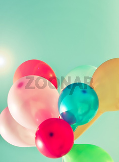Multicolored balloons in the sun