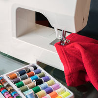 White sewing machine and red cloth