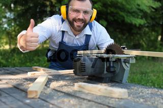 beard man working on Circular saw
