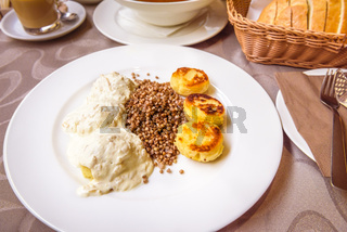 Boiled potato dumplings with onions and cream