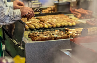 Bratwurst on the grill grid at a booth at the Christmas market in Braunschweig, Germany