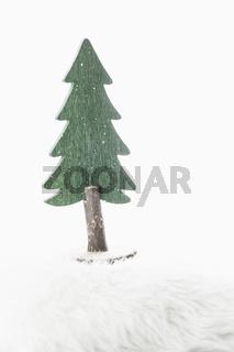 Eine Tanne - ein Dekoobjekt zu Weihnachten im weichen Ambiente.