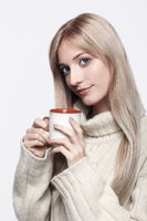 Blonde woman drinking a cap of tea