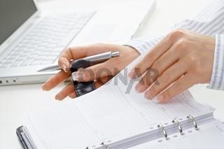 Femal hand turning page