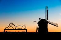 Lying man on a bench at windmill de Goliath
