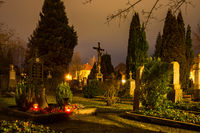 Illuminated graves at an historic graveyard