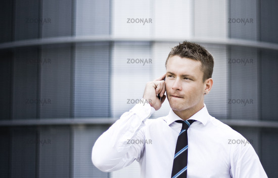 Photo Of A Busy Corporate Man On The Cell Phone