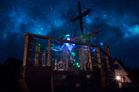 Colorful ghostly lighttrails on a deck of a pirate ship