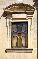 Stained glass window depicting a Maltese cross. Rabat. Malta