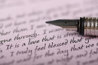 A pen on a love letter written on purple paper