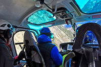 Pilot and passengers during a transport flight in a helicopter, Pennine Alps, Switzerland