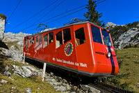 Red railcar of the Pilatus Railway on the way to the top of Mount Pilatus, Alpnachstad, Switzerland