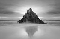 Moody skies over Pyramid rock sea stack