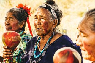 Old Paraguayan indigenous Guarani Women perform a Song