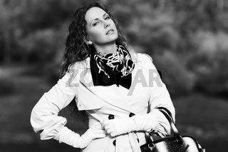 Happy fashion woman with long curly hairs outdoor