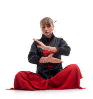 Woman practicing wushu on the floor isolated shot
