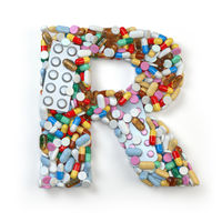 Letter R. Set of alphabet of medicine pills, capsules, tablets and blisters isolated on white.
