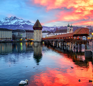 Dramatic sunset over the old town of Lucerne, Switzerland