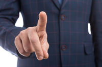 Businessman index finger touching invisible transparent screen