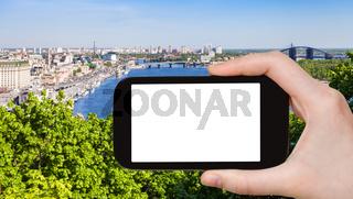 tourist photographs Kiev city with Dnieper River