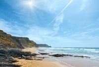 Sunshine above Atlantic rocky coastline (Algarve, Portugal).
