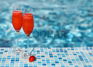 Champagne glasses with strawberry. Rossini cocktail. Summer pool party