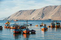 Iquique, Chile - March 16, 2011: Colourful wooden fishing boats in the harbour are resting after the storm