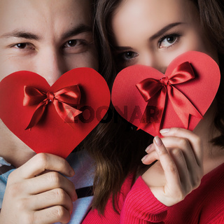 Couple with valentine's heart cards